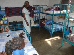 Mary Kabiito in the girls' dorm at Kakunyu